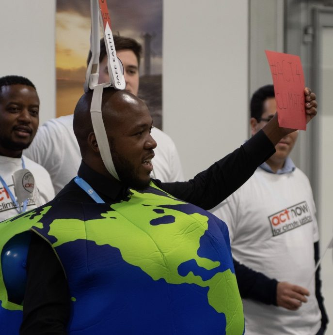 "What suits the Earth suits us - Khulekani Magwaza of SAYCCC at COP24 last December, ""Our message was that the earth is sick because of temperature increase (indicated by cardboard on my heard). Key asks in this stunt included demonstrating that we need more and better climate finance, inclusion of gender in discussions, rights based adaptation plans, and low carbon development."""